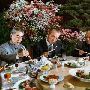 President Nixon gamely tries out his chopsticks at a banquet given in his honor,  1972. Credit: White House Photo Collection.