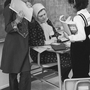 Sister Mary Abdi talking over homework assignments with Rohymah Toulas and Lanya Abdul-jabbar at the Islamic School in Seattle, Washington. Library of Congress