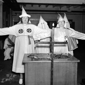 Attention has been focused on the almost mythical Ku Klux Klan organization in the United States, following the allegations that Senator Black, the new Supreme Court judge, was a member of the sect. Virtually unknown, even in the U.S., a women's branch of the Ku Klux Klan has grown into a powerful organization in the south. The women's Klan salute to the cross at Atlanta, Georgia, on Aug. 18, 1937. Source: AP Images