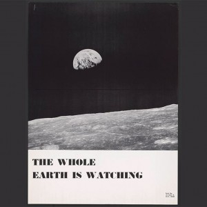 """Image scan of the Earth from the Moon's surface. Caption reads: """"The Whole Earth is Watching."""" Source: Library of Congress"""