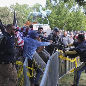"""White nationalists and counter protesters clash in front of the Robert E. Lee statue in Charlottesville, Va.'s Emancipation Park ahead of the """"Unite the Right"""" rally. Photo: Sanjay Suchak"""
