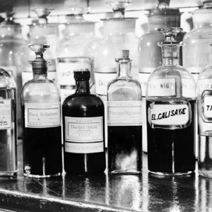 A display of several apothecary bottles containing drugs, on shelf of Eimer and Amind (?) drugstore, 1940. Source: Library of Congress