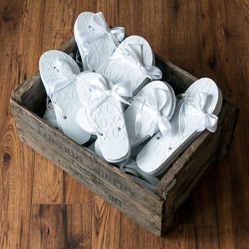 White XO Embossed Flip Flops 8680