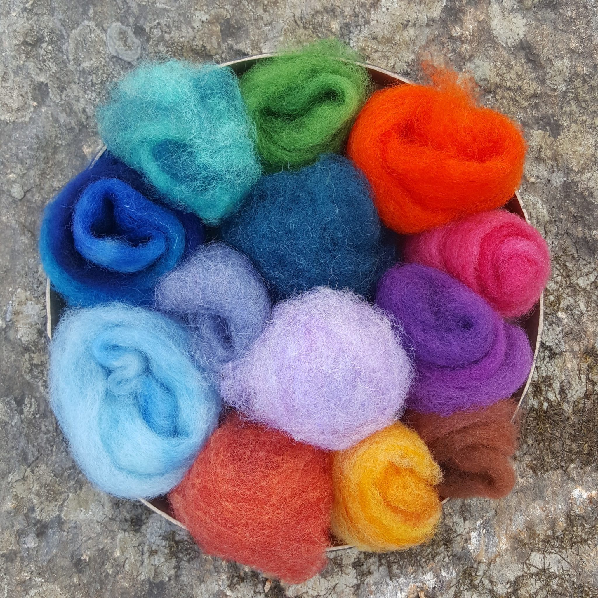 Felting wool in a variety of colors, artist's palette puff pouch