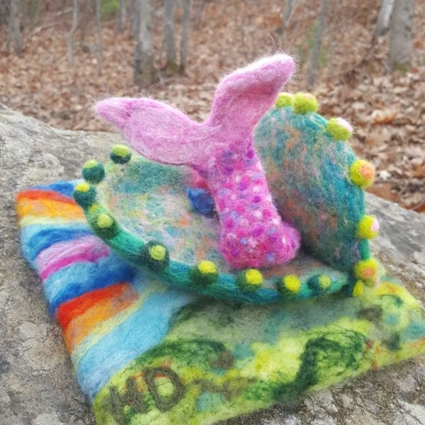 Vieve mermaid swims through a magical shell to Lichendia, a woodland fairyland, by Hillary Dow, felted wool illustration