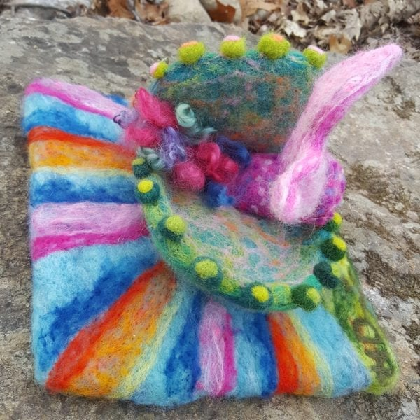 Vieve mermaid swims through shell to Lichendia fairyland by Hillary Dow felted wool illustration