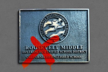 Roosevelt Middle School sign with a red X on it.