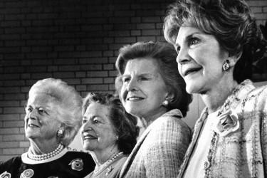 Black and white photo of Barbara Bush, Lady Bird Johnson, Betty Ford, and Nancy Reagan, in 1994.