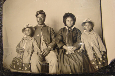 A Union soldier sitting with his family