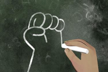 Fist drawn on chalkboard