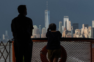 Father and son looking at NYC skyline