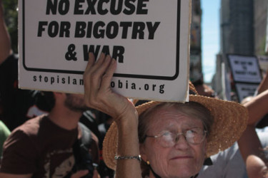 A picture of a woman at a protest against Islamophobia.
