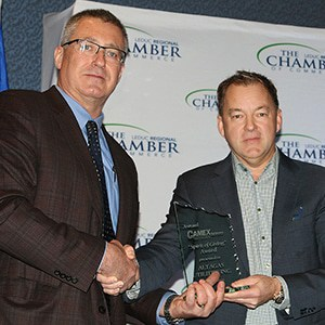 "Camex CEO Andy Fraser hands out ""Spirit of Giving"" award"