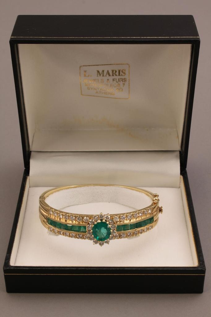 Lot 154: 18K Natural Emerald and Diamond bangle bracelet
