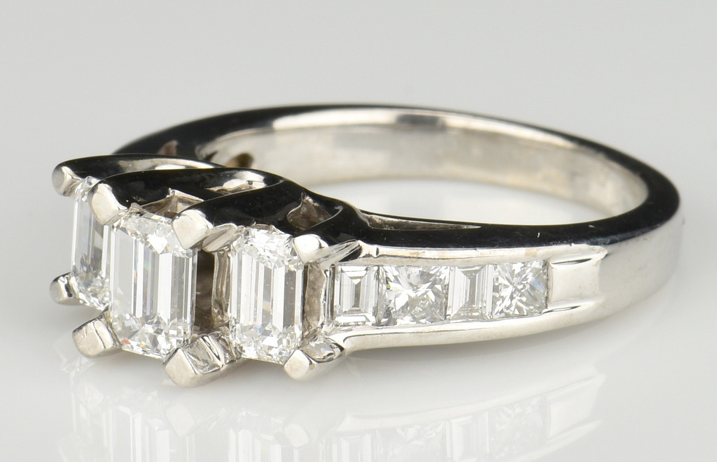 Lot 360: 3 Stone Emerald Cut DIamond Ring