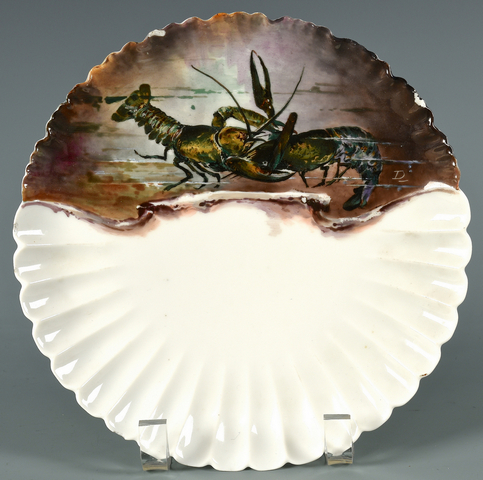 A porcelain fish plate from the Haviland service designed for President Rutherford B. Hayes in 1879, with designer Theodore Davis cypher en verso. Est. $1,800-2,200