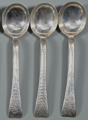 "Three spoons from a 62-piece set of Tiffany's ""Lap Over Edge"" pattern sterling flatware. Estimate for the set: $10,000-12,000"