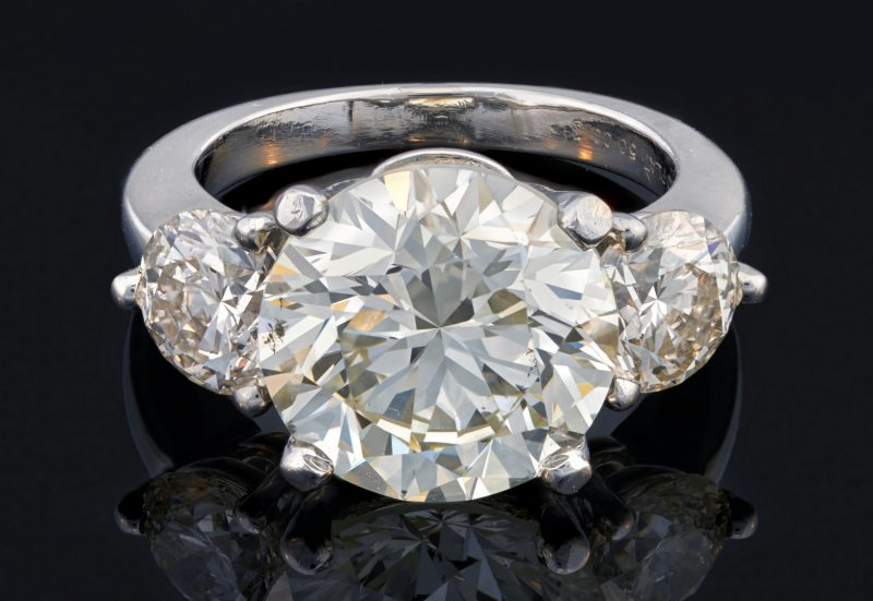 Lot 67: 6.83 ct Round Brilliant, GIA, plat 3-stone, sold $41,300