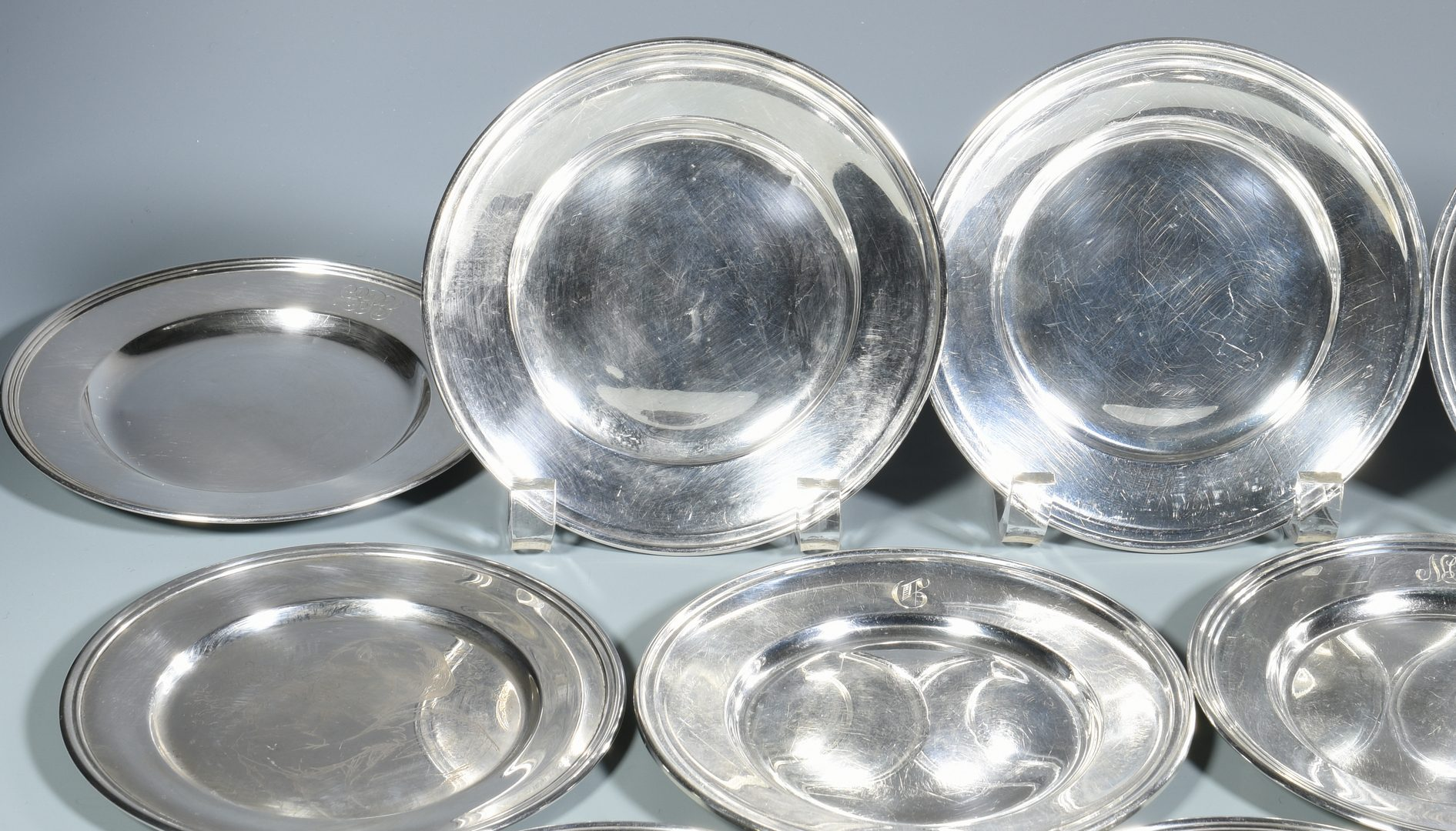 Lot 868: Group 15 Sterling Bread and Butter Plates