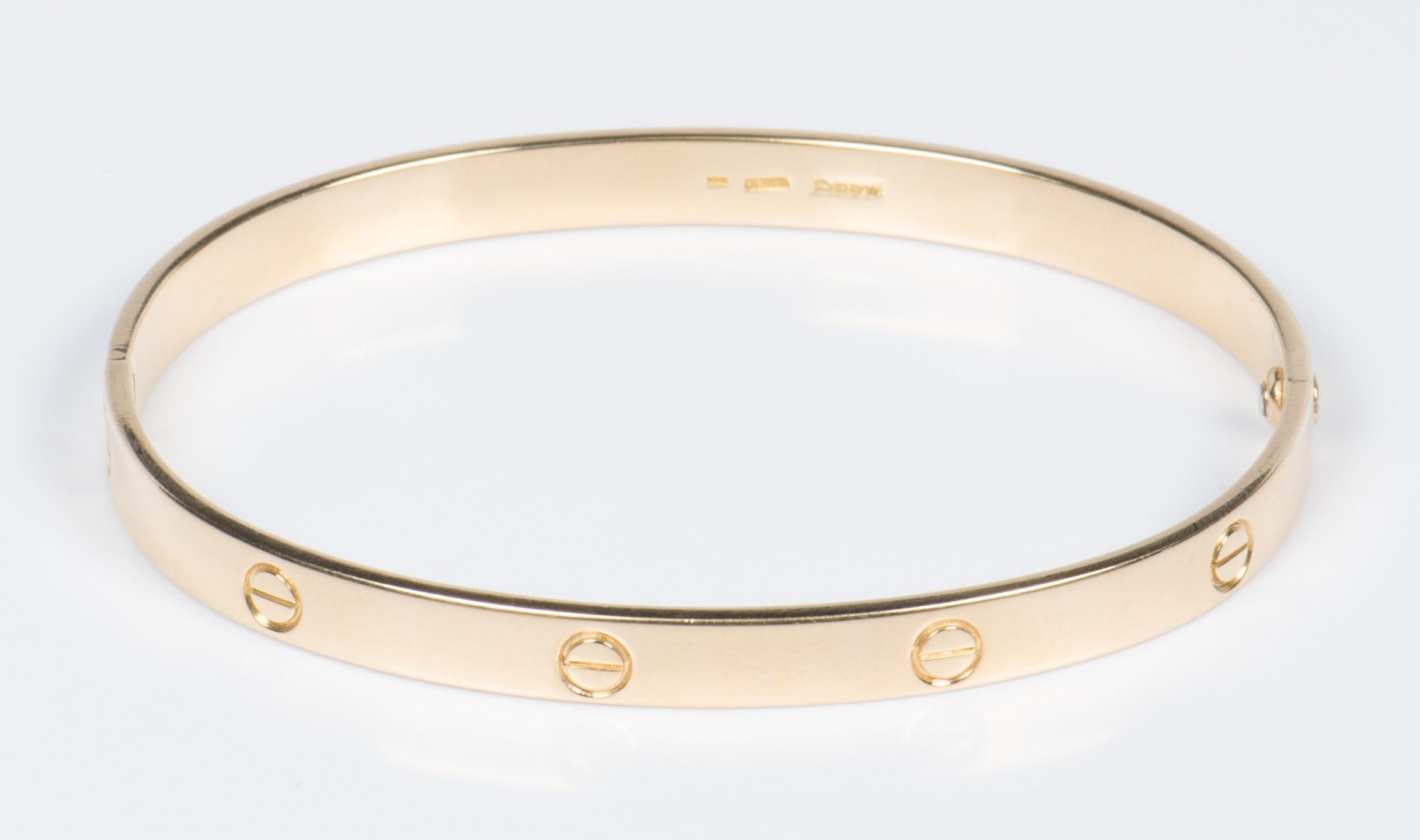 Lot 325: 18K Mayor's Cartier-Style Love Bangle
