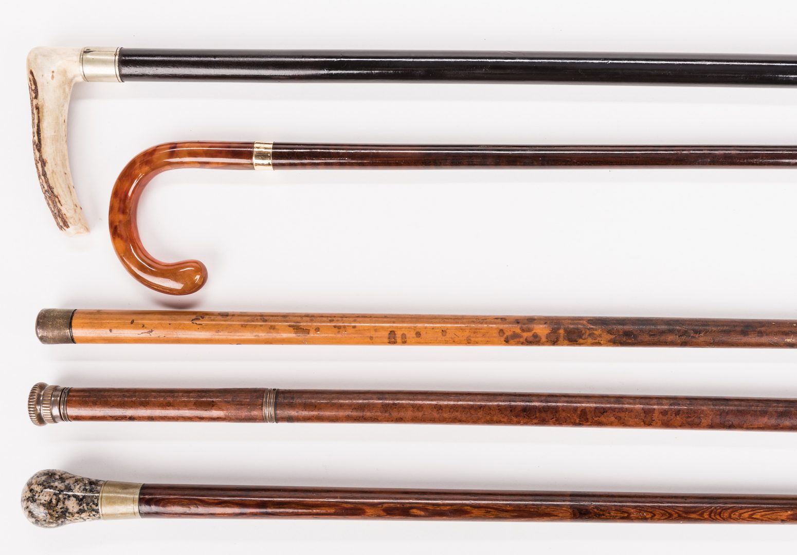 Lot 718: Group of 5 Walking Sticks, inc. Flick Stick