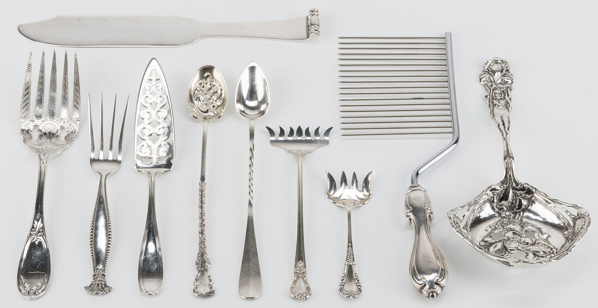 Lot 867: 9 Sterling Flatware Serving Items plus 1