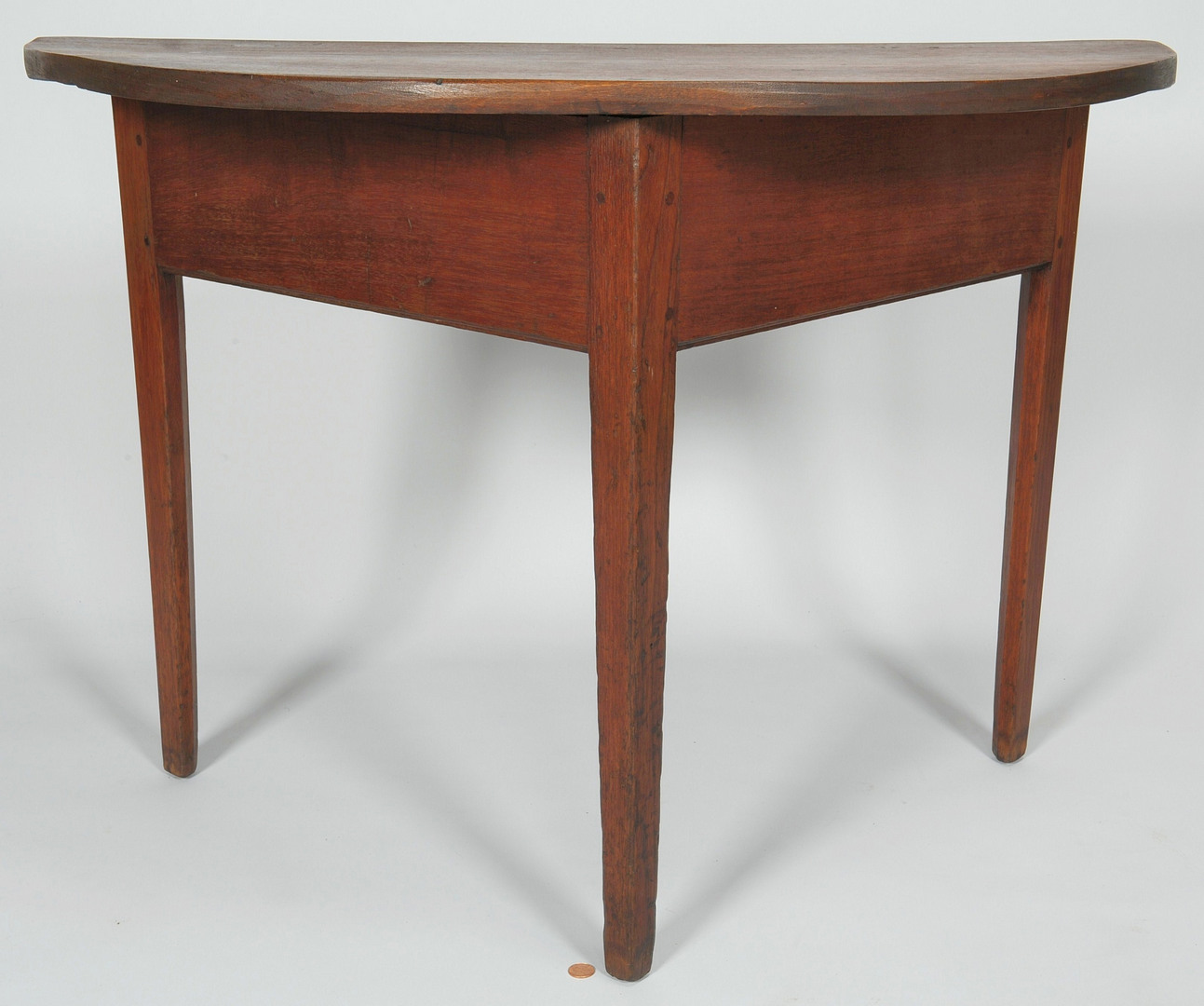Lot 111: Tennessee half round walnut table