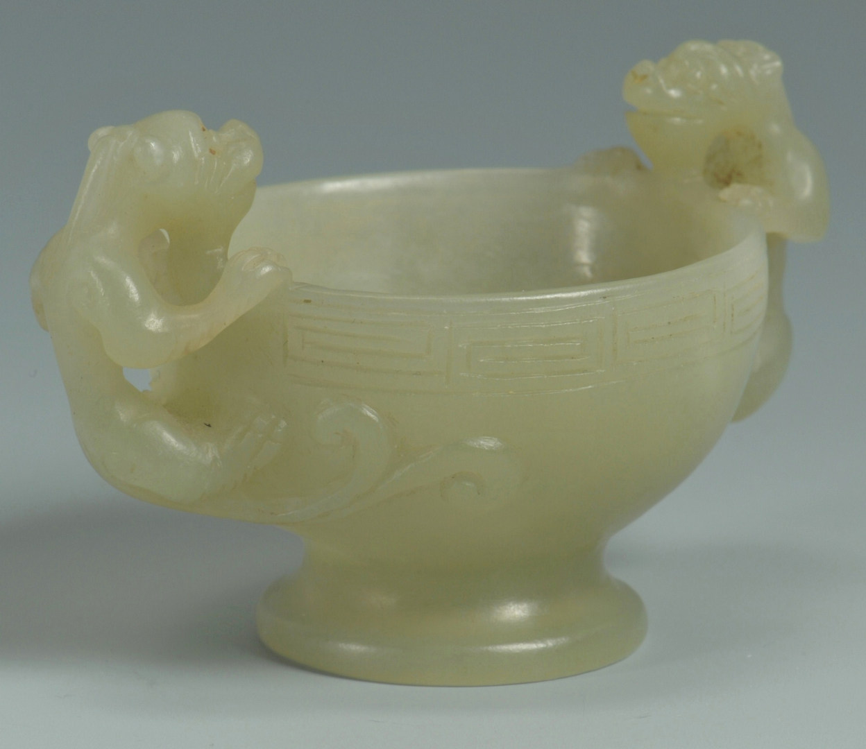 Lot 11: Chinese Jade Footed Cup w/ Foo Dog Handles
