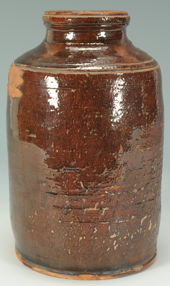 Lot 138: 2 East TN Redware jars, one sine wave, attrib. Cai