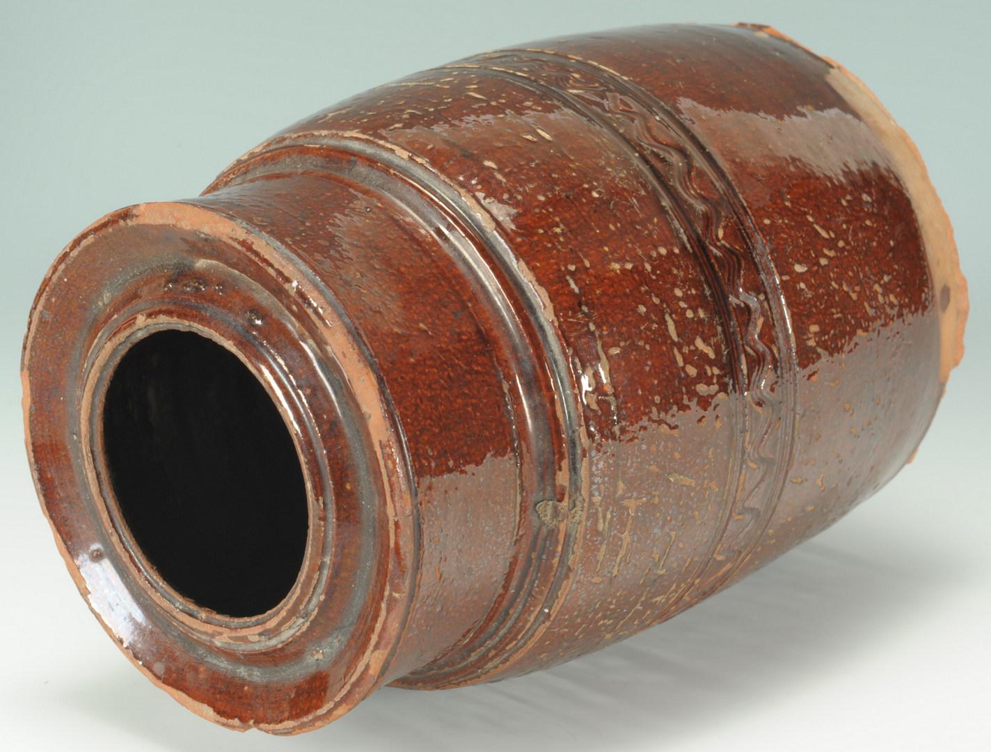 Lot 138: 2 East TN Redware jars, one sine wave, attrib. Cai