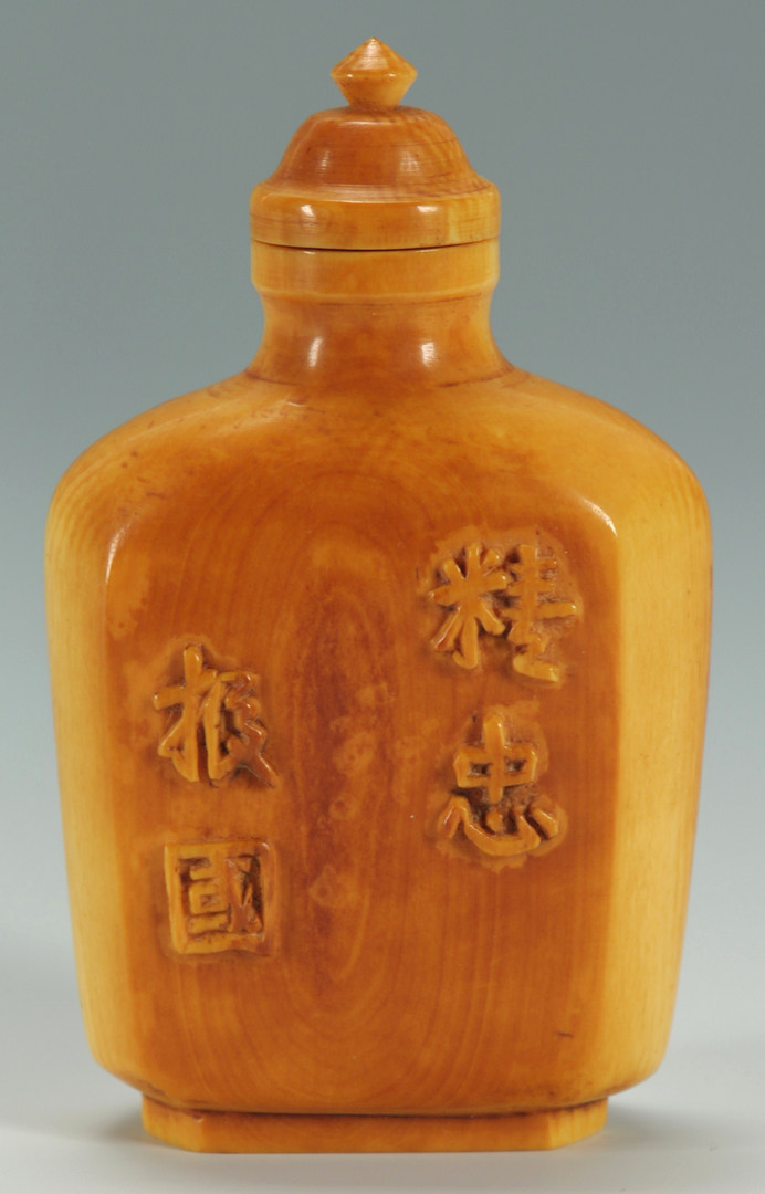 Lot 16: Stained ivory snuff bottle – filial piety theme
