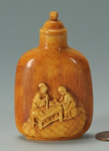 Lot 17: Stained ivory snuff bottle – calligraphy theme