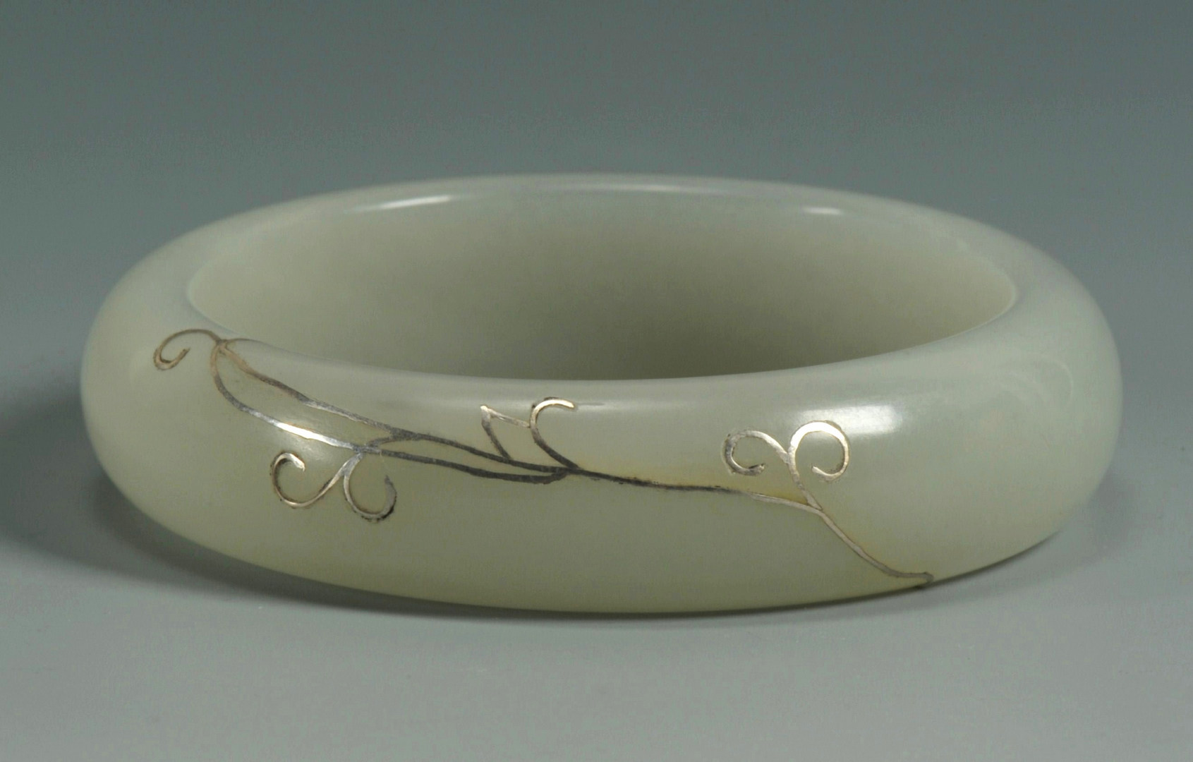 Lot 182: Chinese Celadon Jade Bangle w/ Silver Inlay