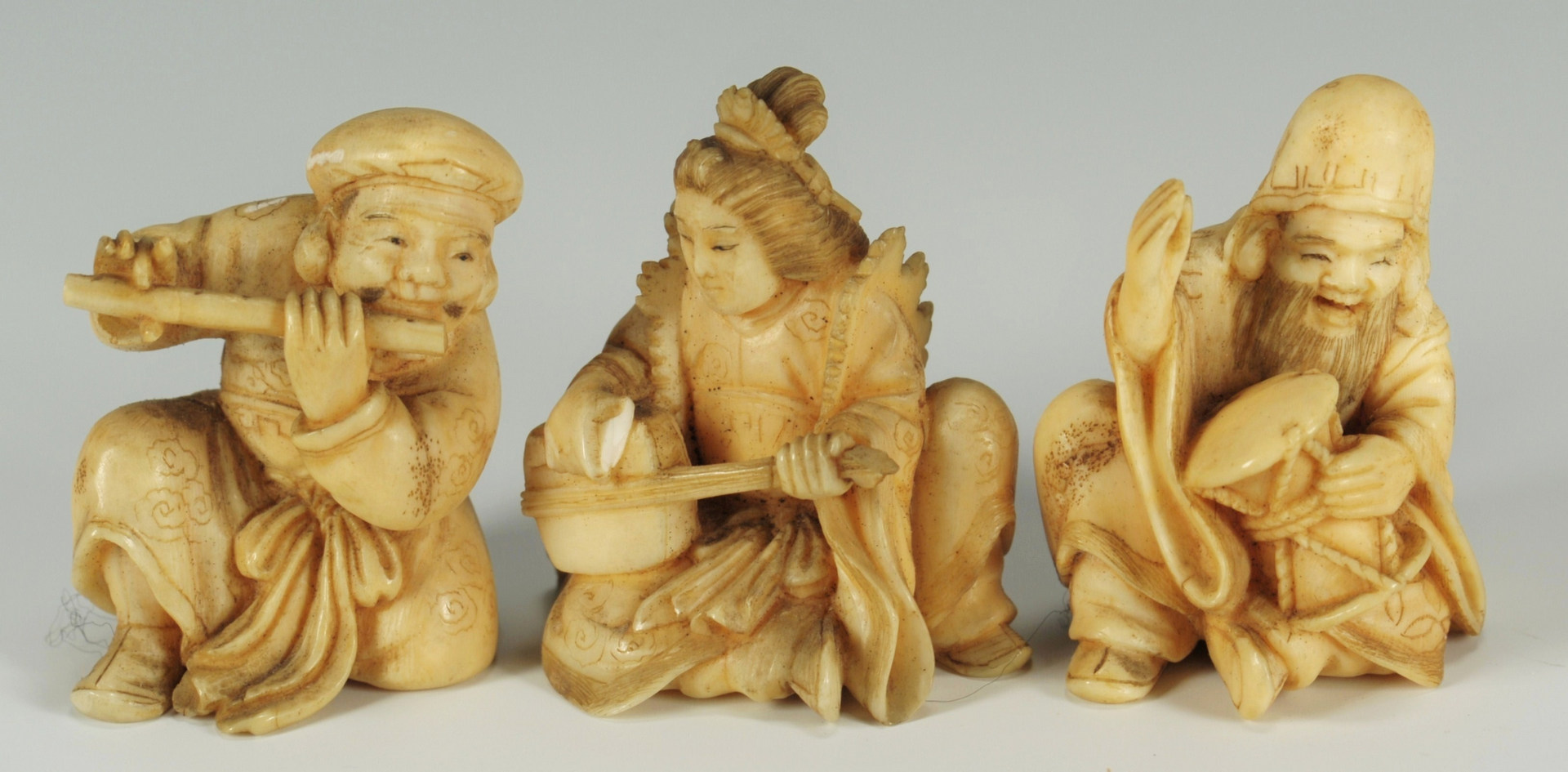 Lot 191: 3 Japanese carved ivory musician figures