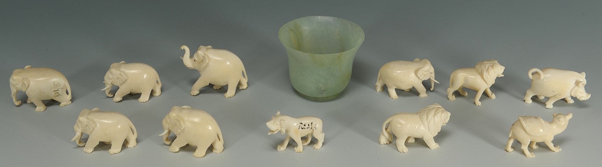 Lot 192: 11 Carved ivory animals and a Chinese jade wine cu