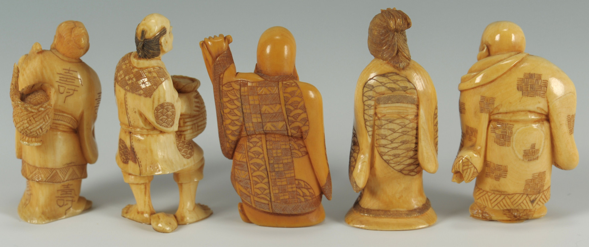 Lot 194: Five signed Japanese Carved Ivory Figures