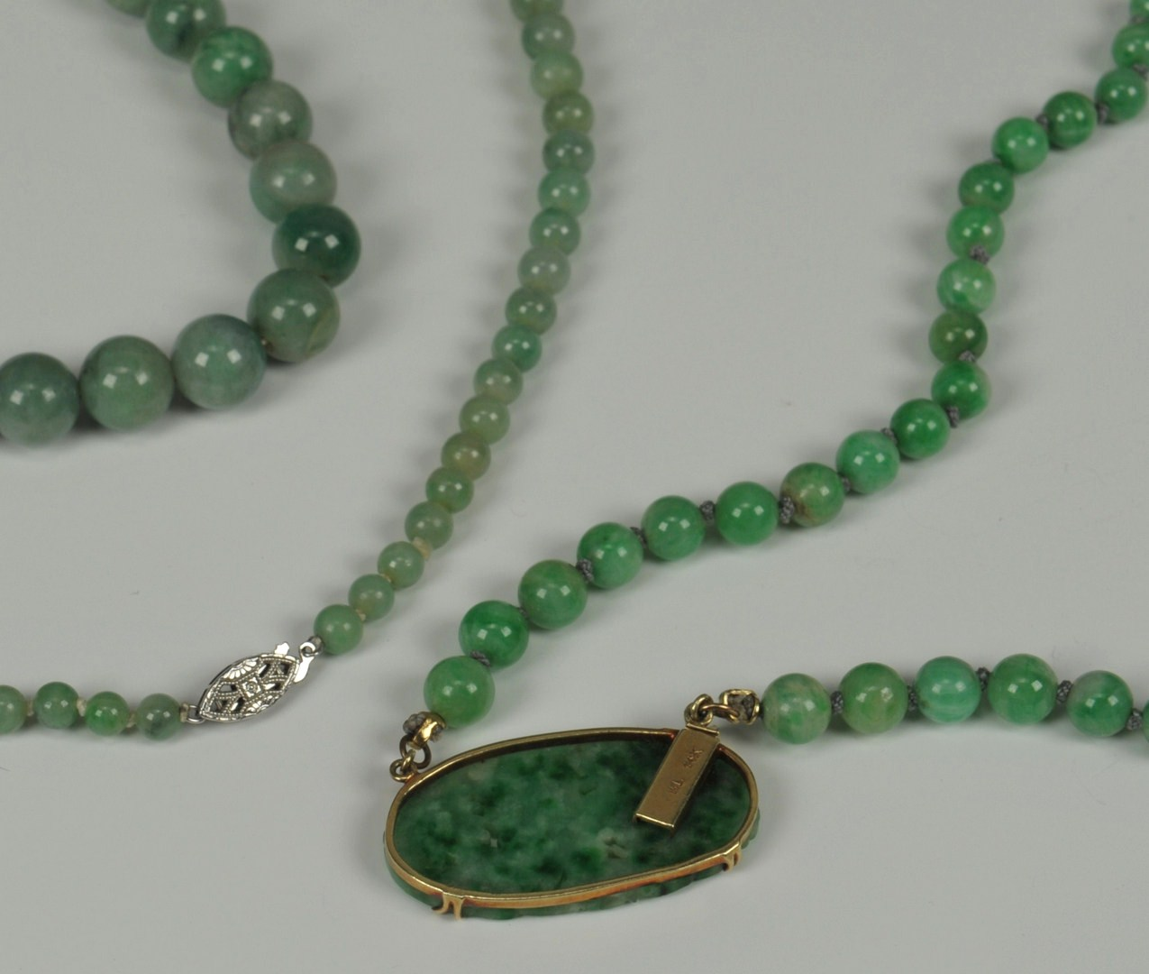 Lot 213: Two Jade and gold necklaces