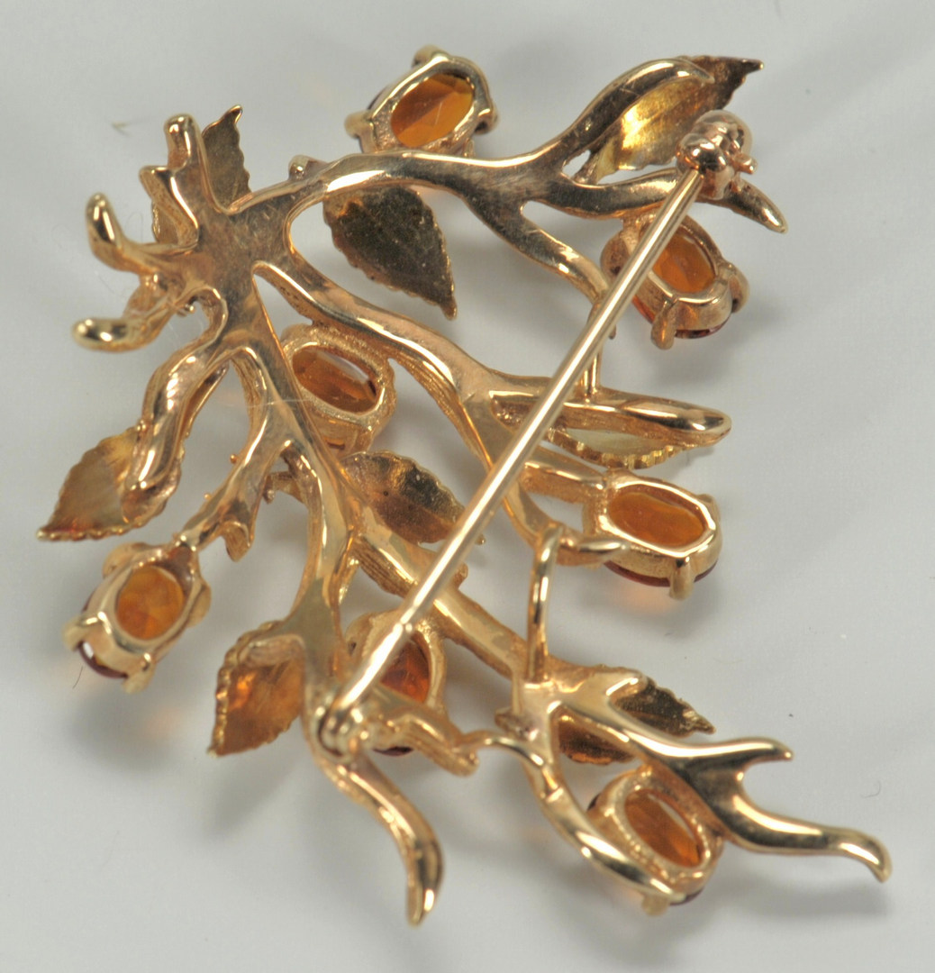 Lot 220: 14K gold branch style brooch with stone flowers