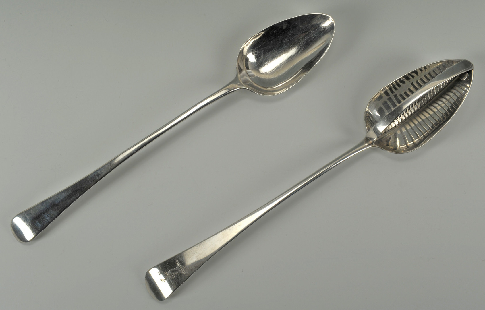Lot 225: George III Sterling Straining & Stuffing Spoons