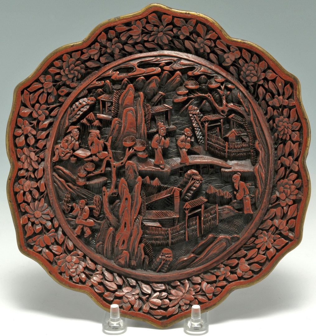 Lot 22: Pair of Chinese carved cinnabar lotus plates