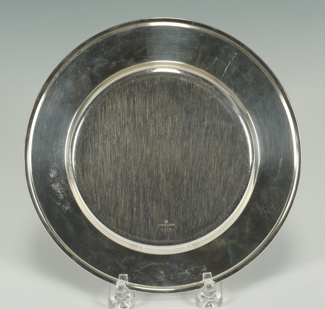 Lot 239: Twelve Towle sterling bread plates, Art Deco monog