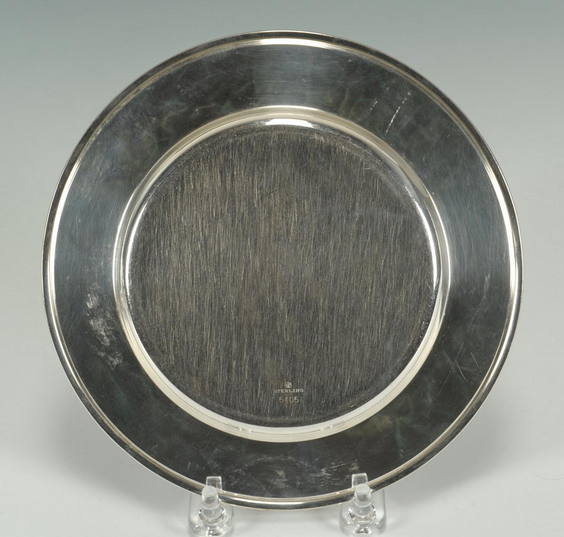 Lot 239: Twelve Towle sterling bread plates, Art Deco monog