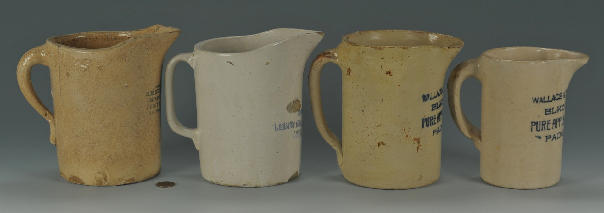 Lot 294: Four Kentucky Pottery Vinegar Pitchers