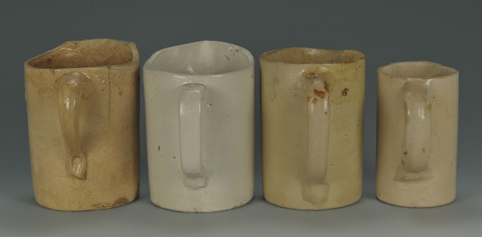 Lot 294: Four Kentucky Pottery Vinegar Pitchers