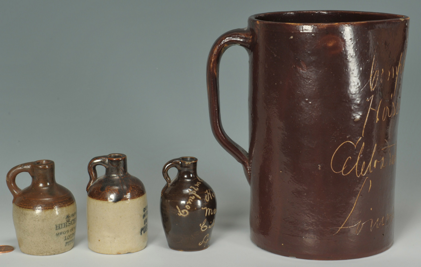 Lot 297: Three miniature KY vinegar Jugs and Pitchers