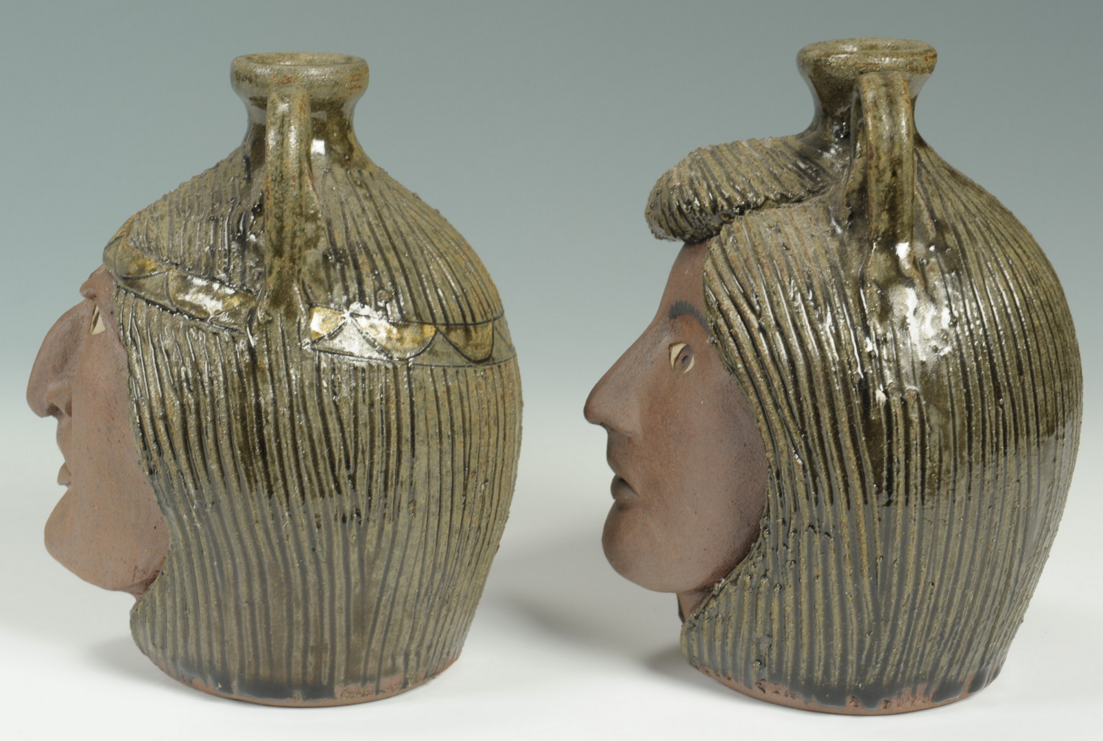 Lot 306: Pr. of Miniature Crocker Indian Face Jugs