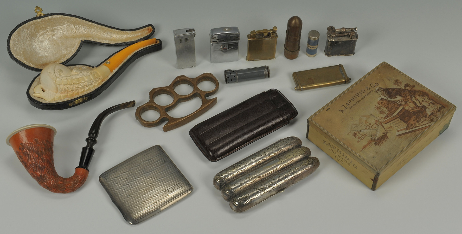 Lot 374: Lot of smoking related items and pr brass knuckles