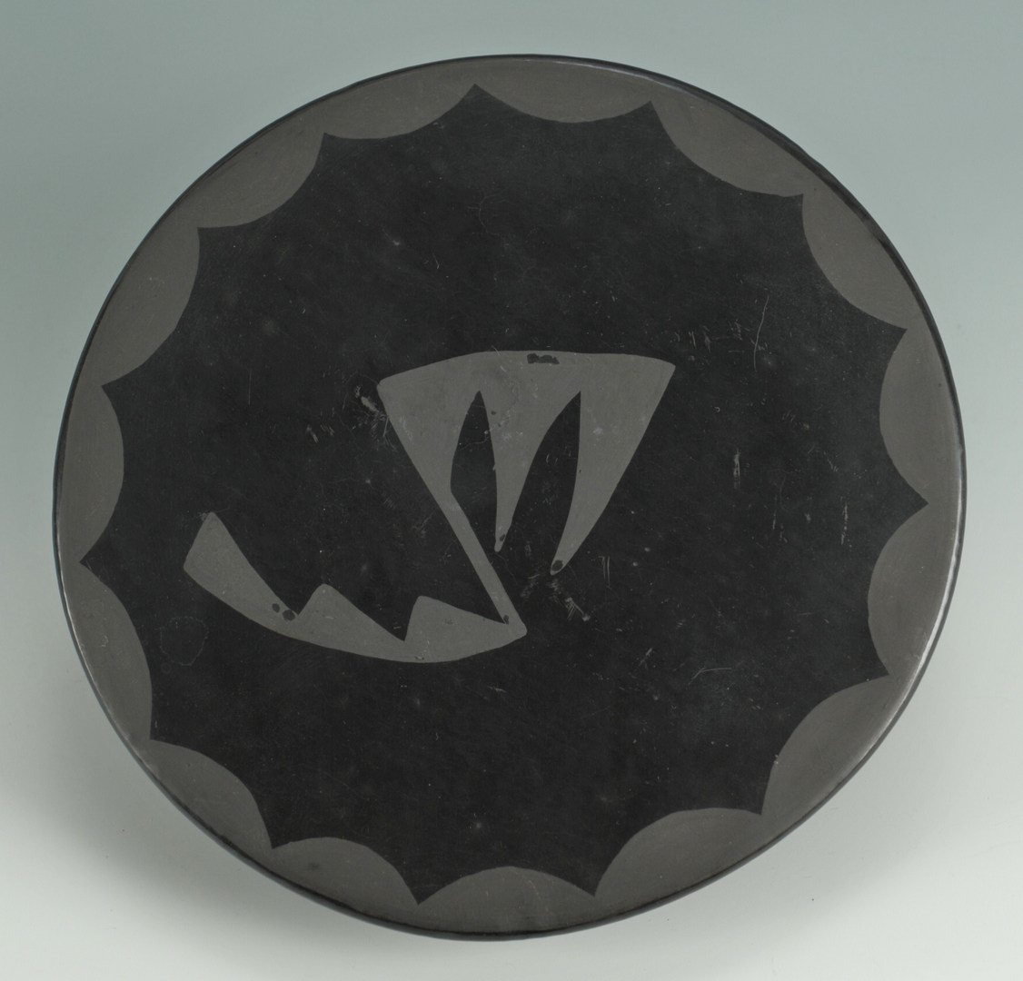 Lot 394: San Ildefonso blackware trivet, Blue Corn