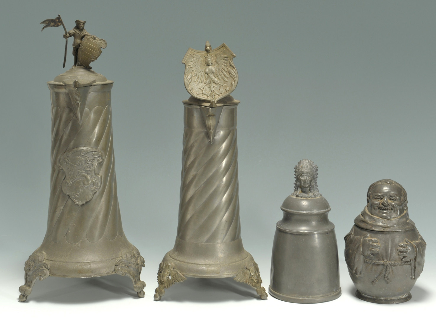 Lot 410: 4 Figural Pewter Steins and pitchers