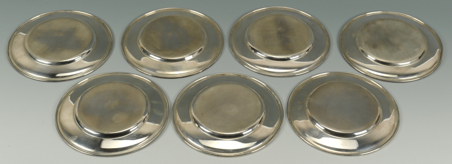 Lot 421: 7 Gorham Sterling Silver Bread Plates
